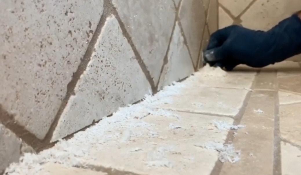 Remove all the soap scum deposits using razor blade